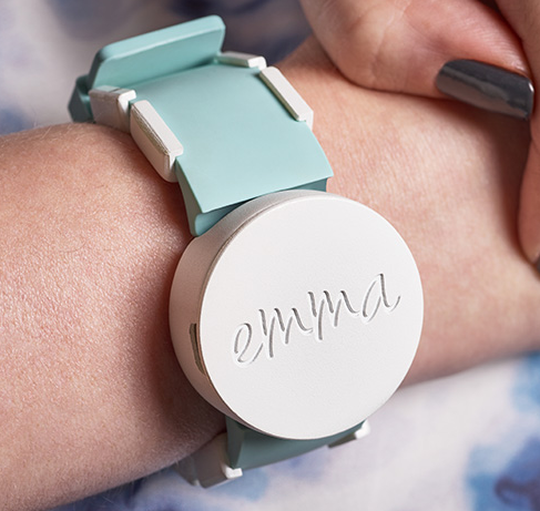 A person's wrist with the Emma watch being worn