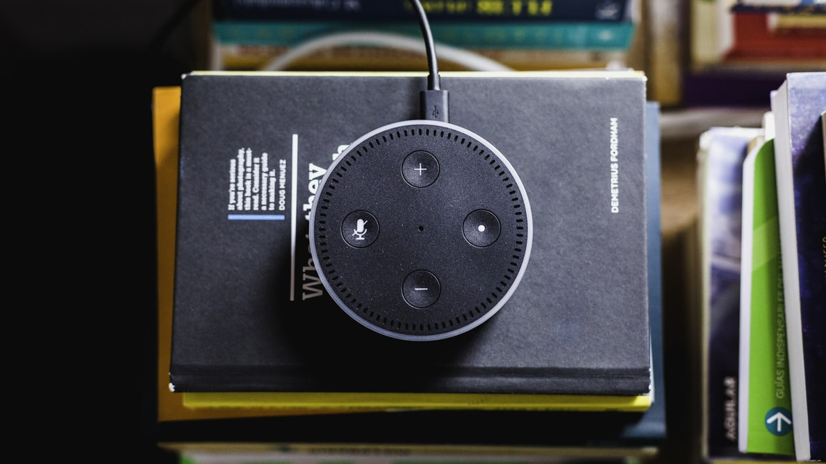 Amazon Echo on top of some books