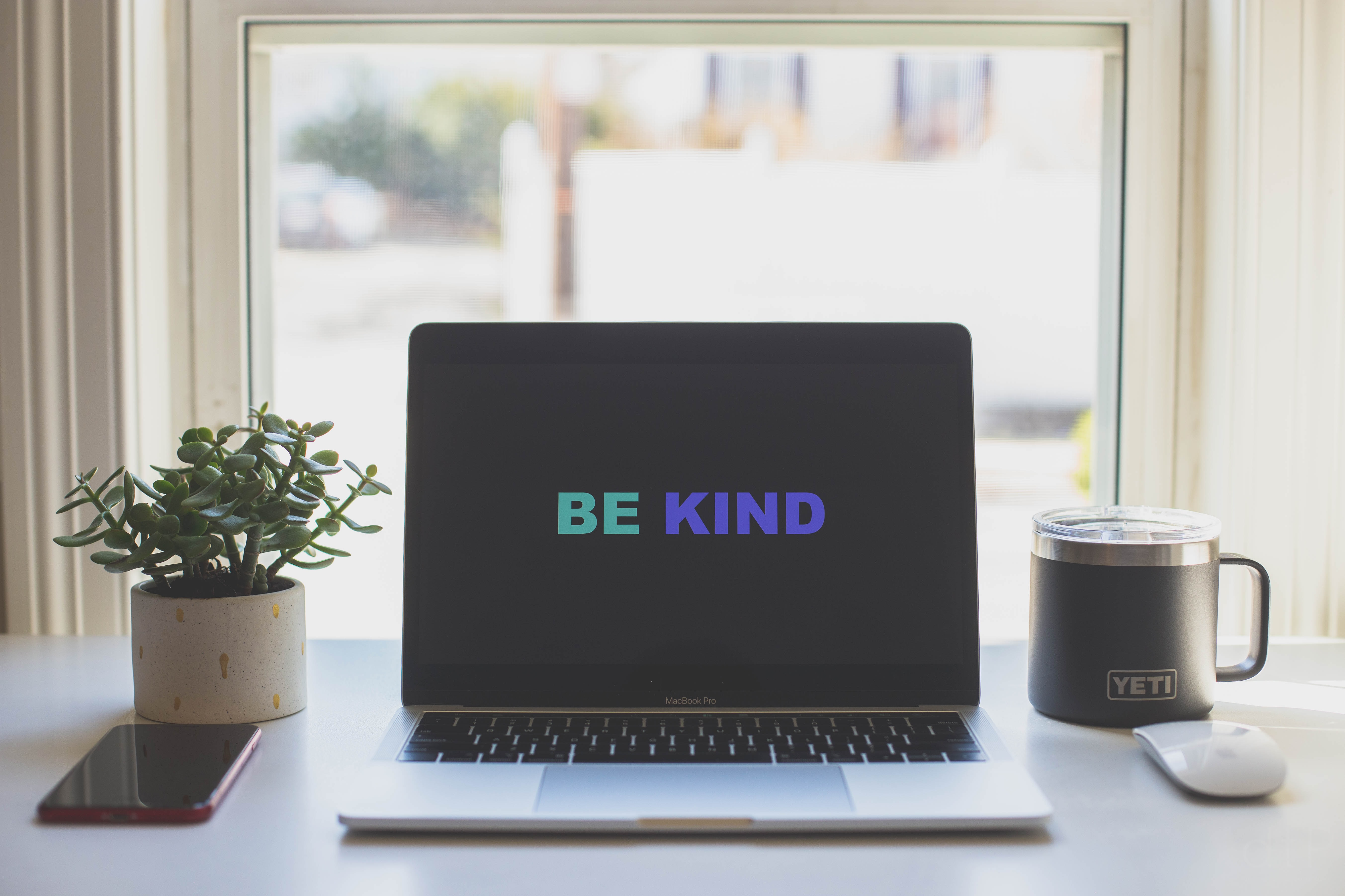 Laptop screen saying Be Kind