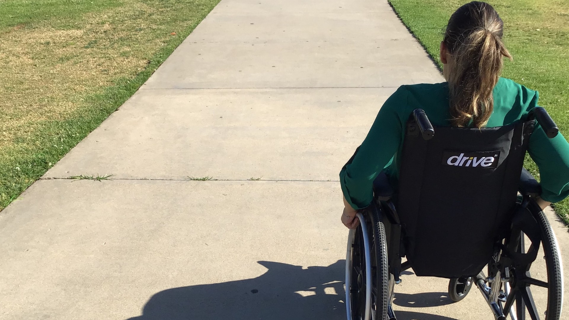 Person in wheelchair on pathway
