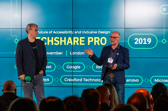 Colour photo of Mark Walker and Christopher Patnoe presenting at TechShare Pro