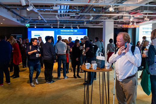 Colour photo of people networking during coffee break at TechShare Pro