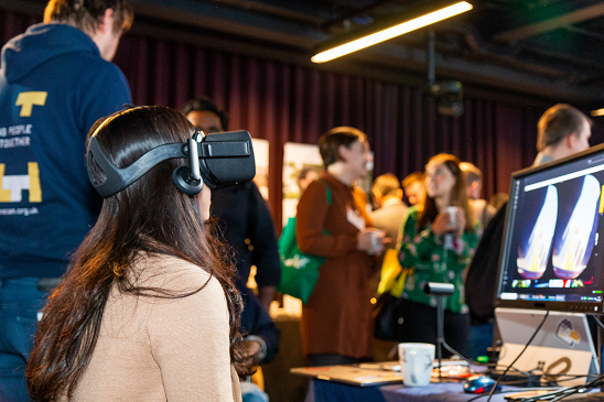 Colour photo of Oculus Rift in use