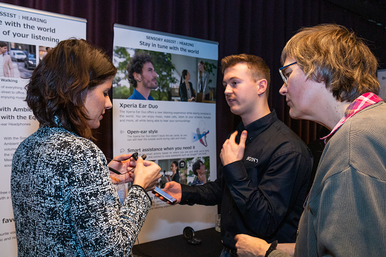 Colour photo of three people networking