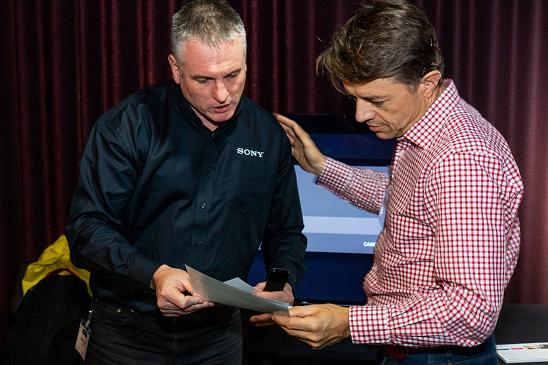 Photo of Sony team member talking to Matthew Johnston