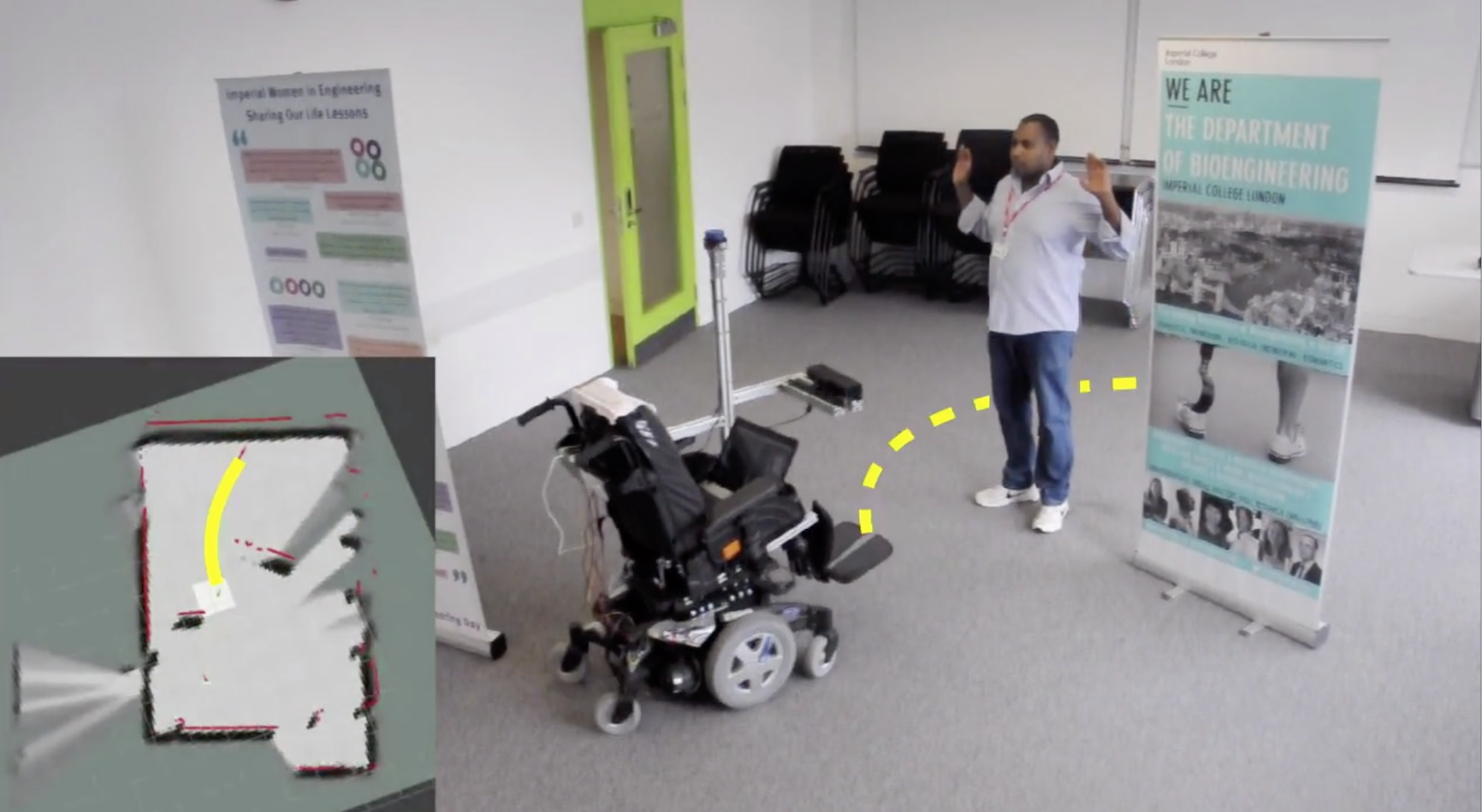 AI powered wheelchair crosses a room avoiding obstacles