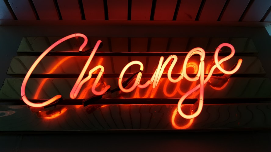 A neon sign with the word 'change' lit up