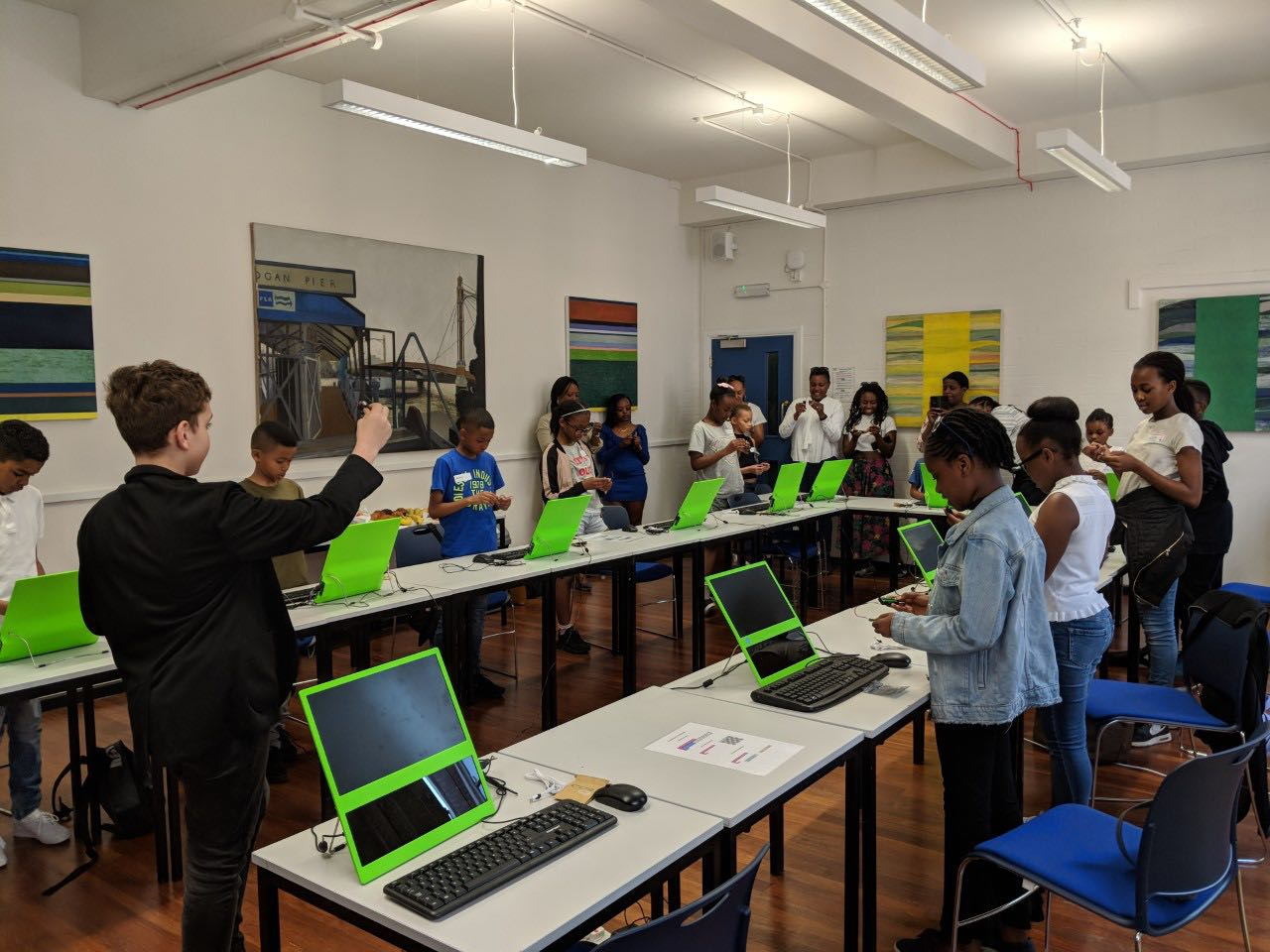 Photo of Femi running a coding workshop for children