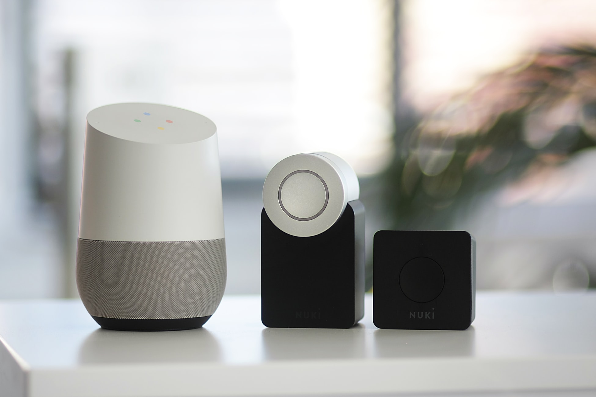 Shows different designs of Google smart speaker in a row