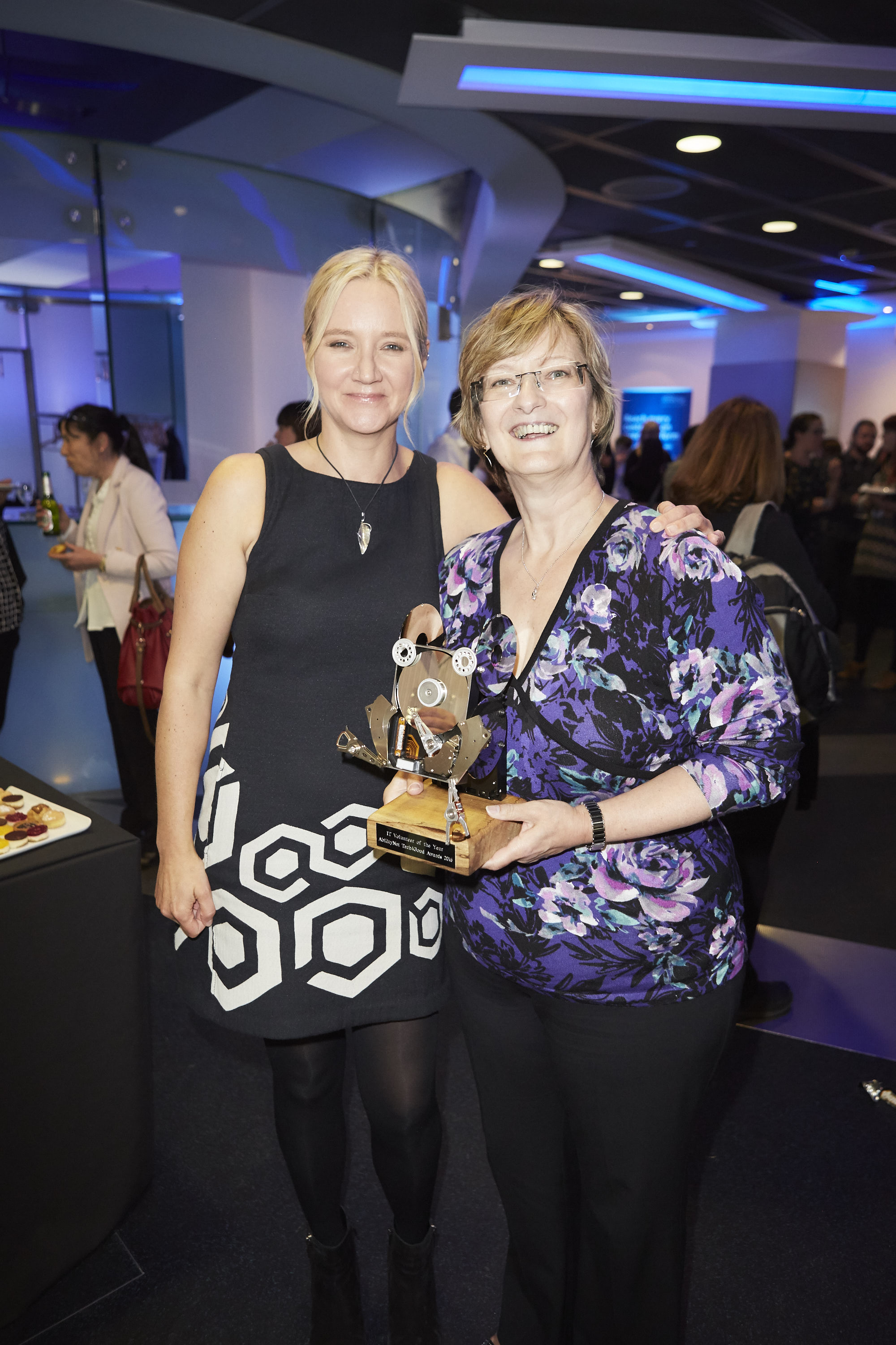 Kate Russell and T4G winner Maureen Johnson of Silver Line smiling at awards ceremony