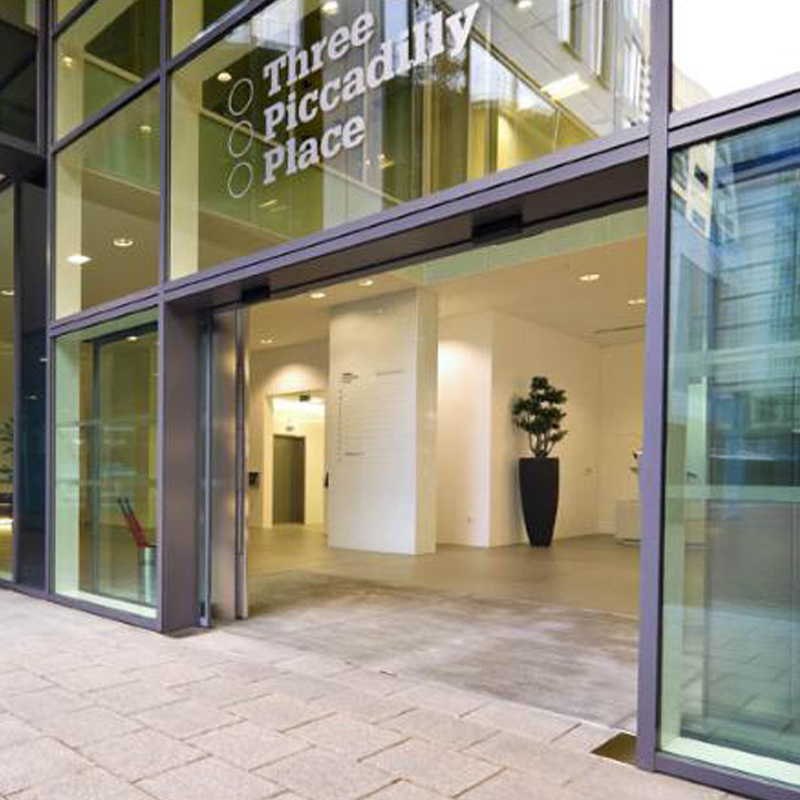 AbilityNet's Manchester DSA Centre - an entranceway with text that reads 'Three Piccadilly Place'