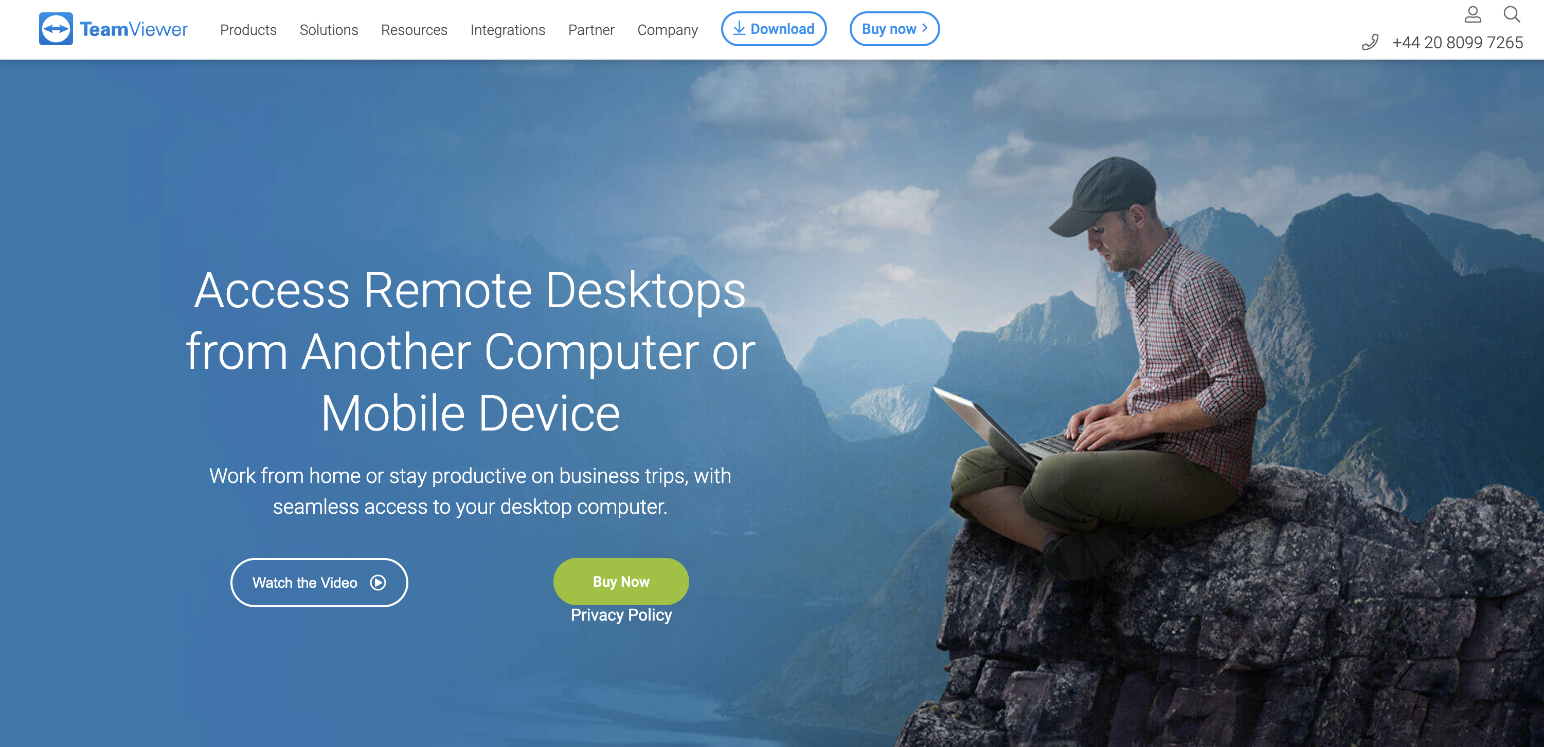 Shows a screenshot of the TeamViewer website a man sits on top of a mountain working on a computer to imply remote support