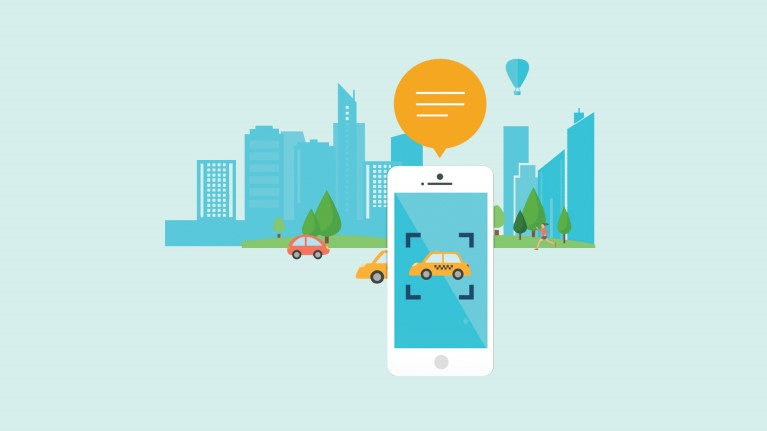 Vector graphic image via Microsoft website of a mobile phone camera being used to read aloud that there is a taxi on the street