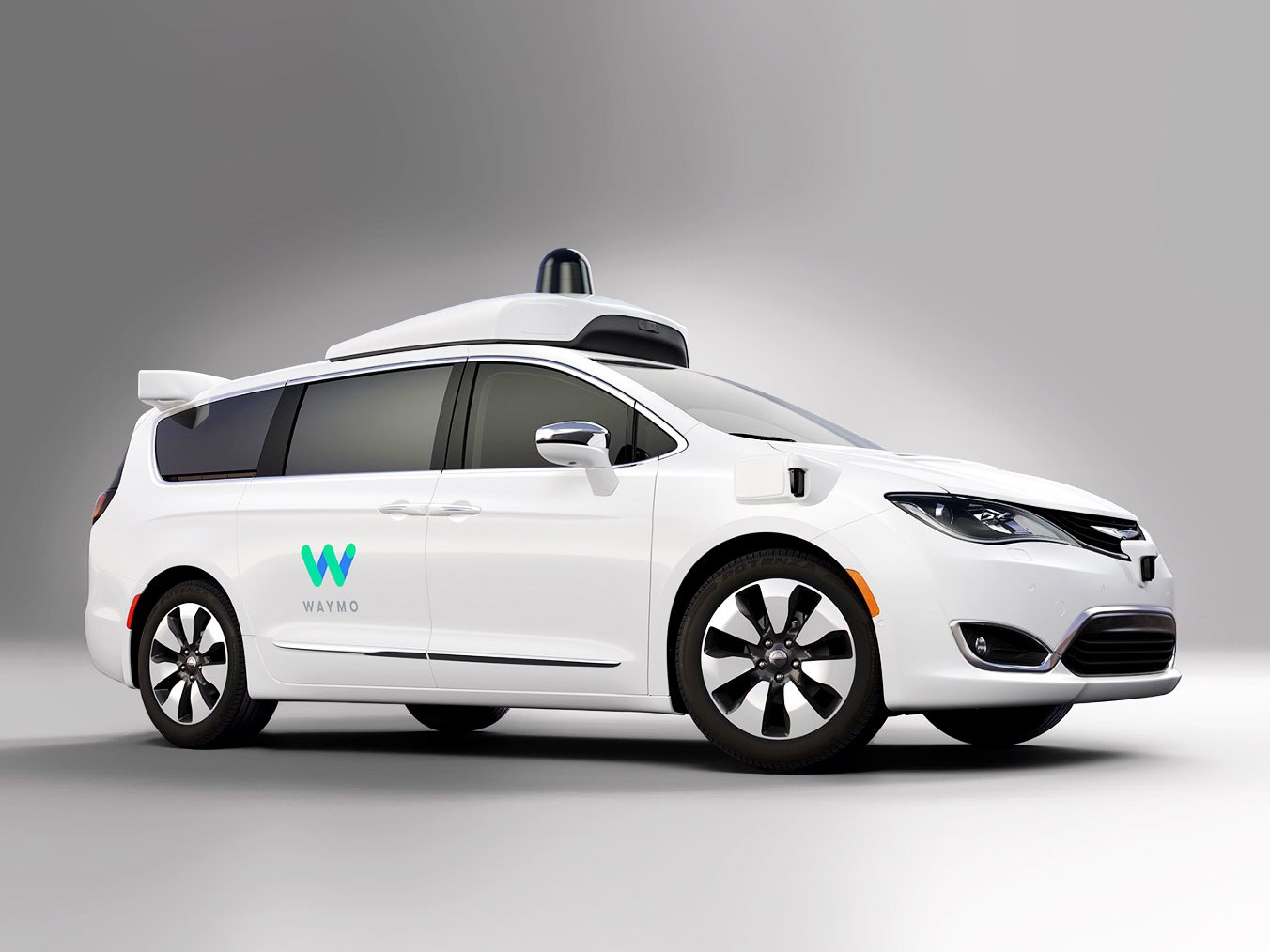 Photo of a white Waymo taxi