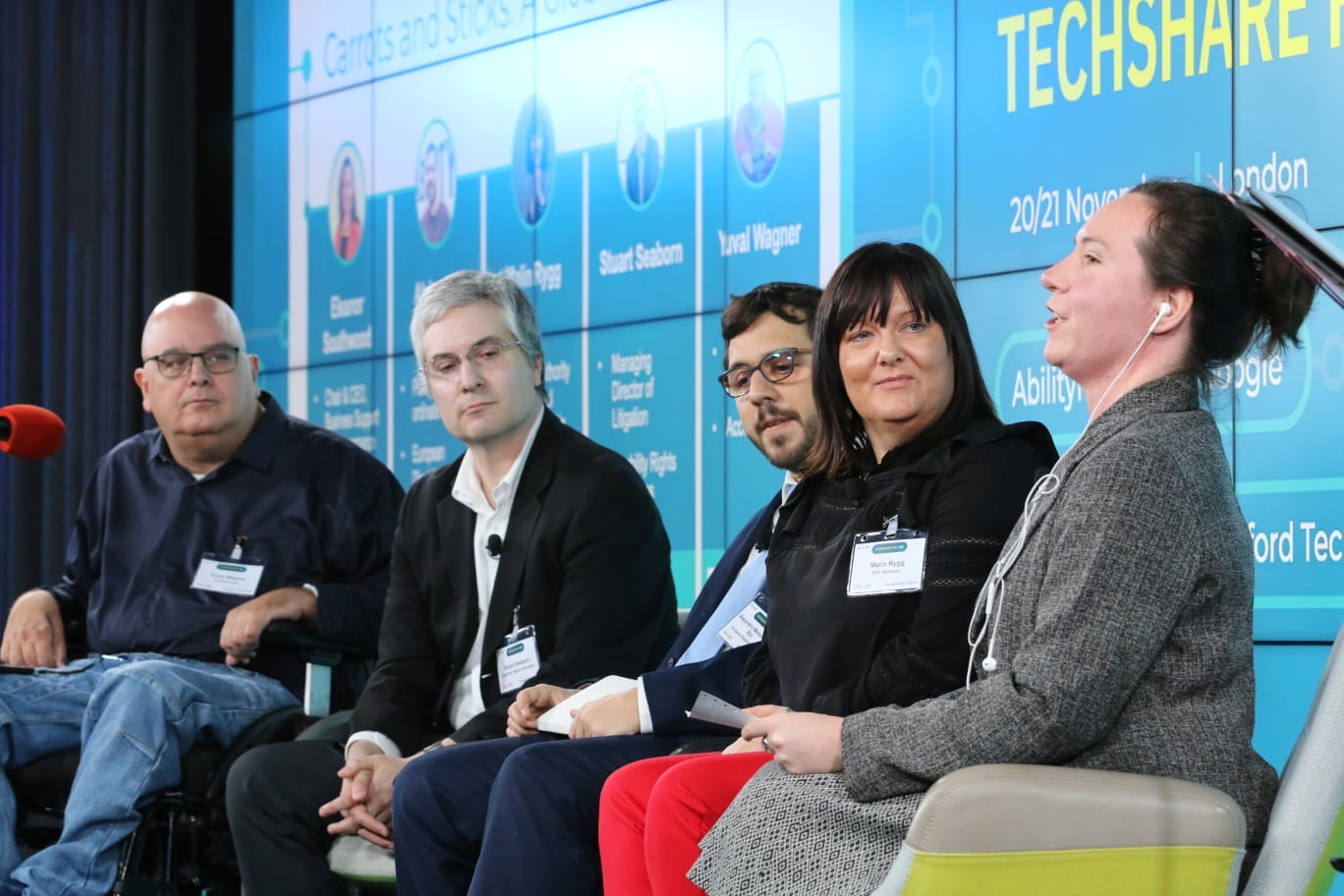 Panelists on stage at TechShare Pro, giving a global perspective on accessibility