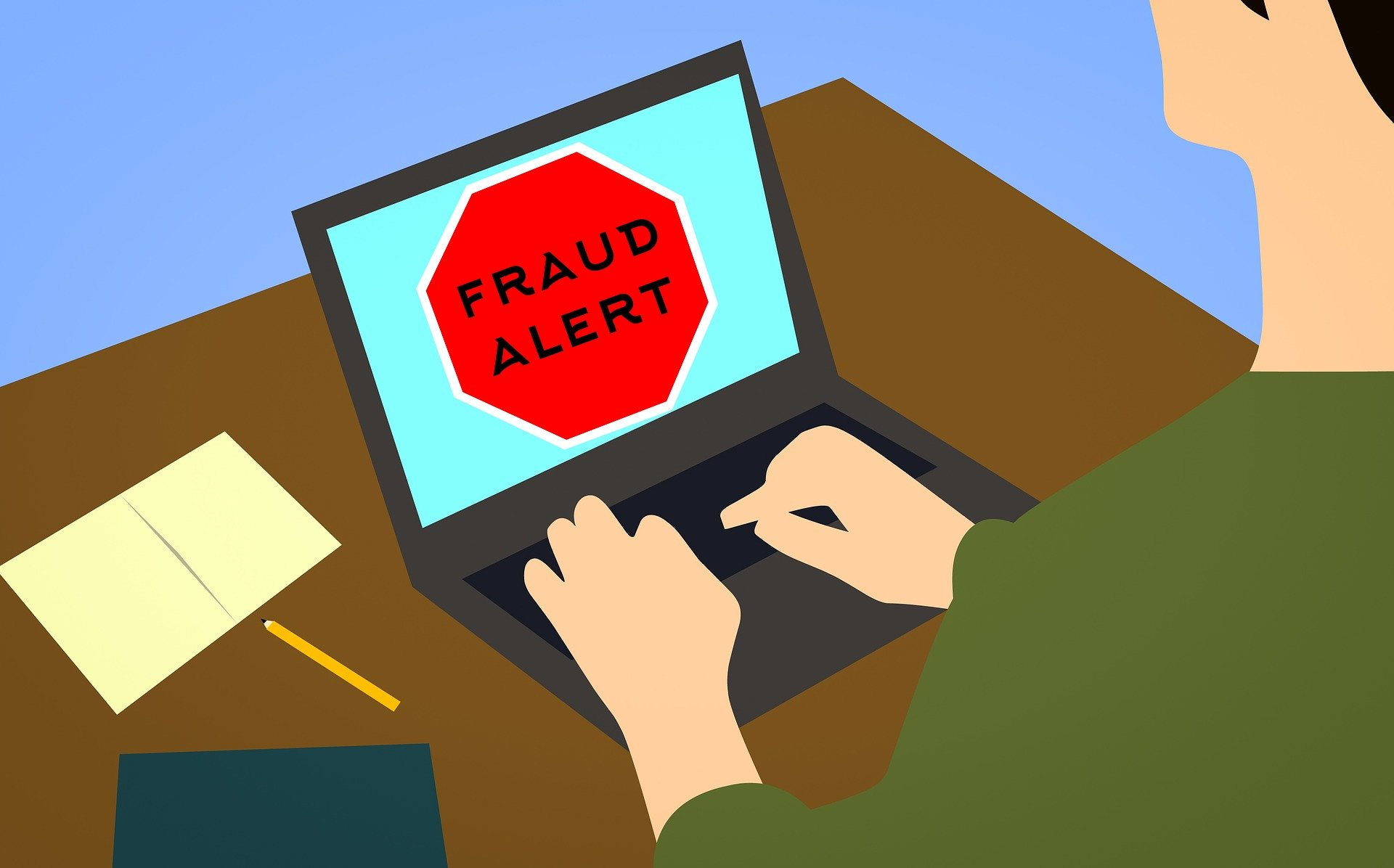 Shows an illustration of someone typing into a keyboard. Words on-screen read 'Fraud Alert'