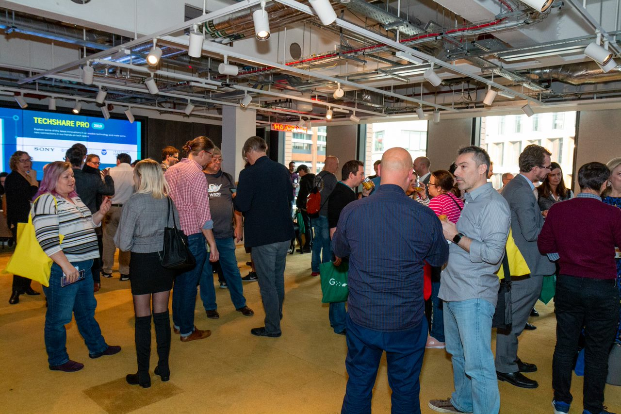 Image shows people networking in the shared space at TechShare Pro 2019