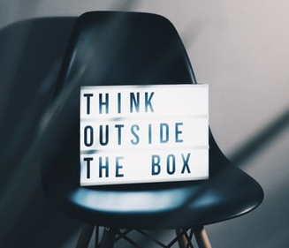 A lightbox on an office chair with the words think outside the box