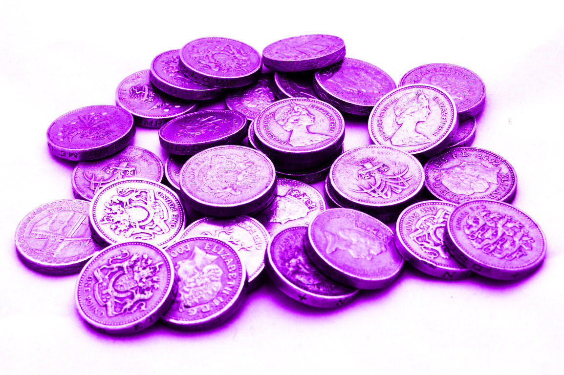 A pile of purple pound coins representing the Purple Pound