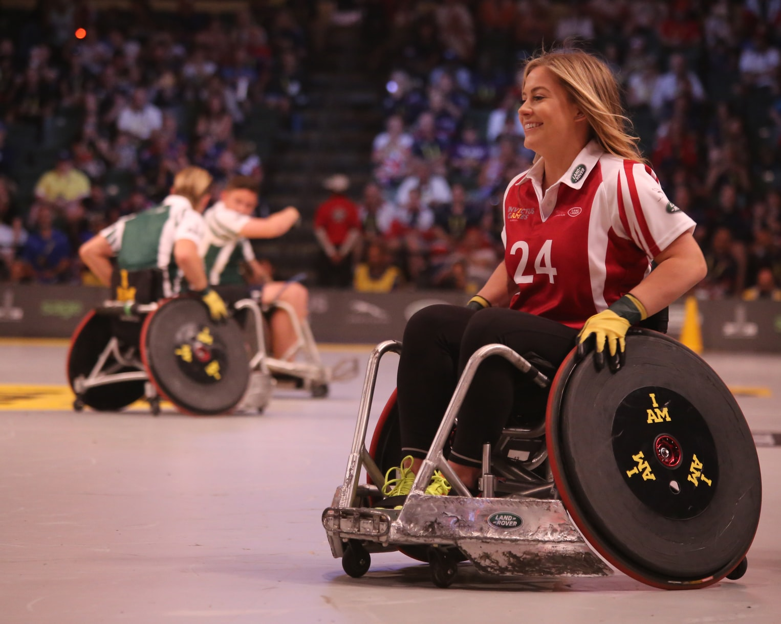 Image shows a woman in a wheelchair wearing a sporting top