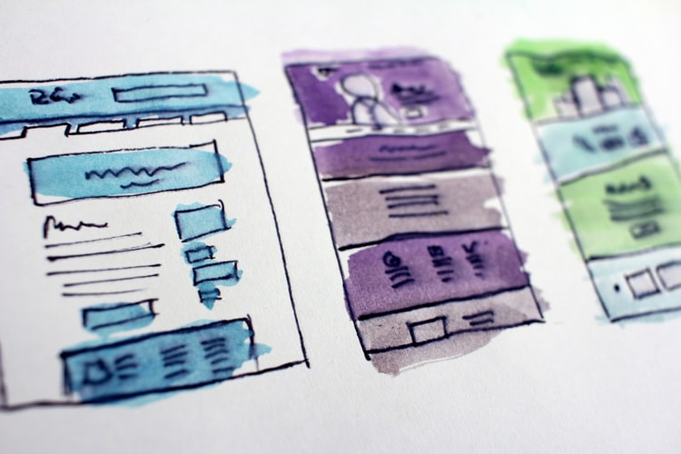 Shows coloured sketches of a website design