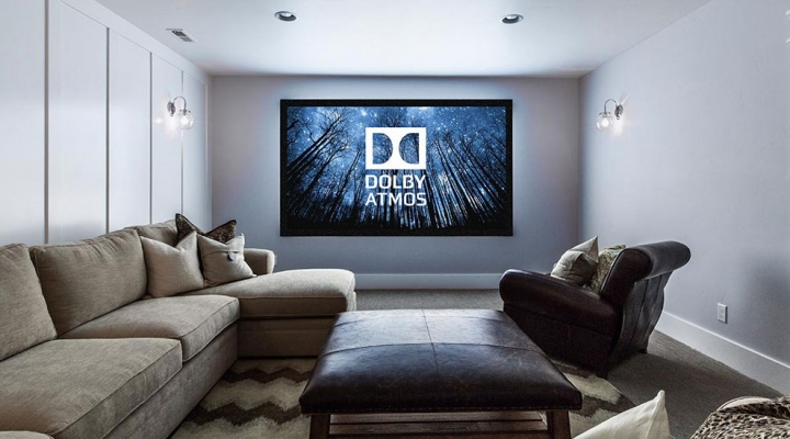 Dolby Atmos displayed on large screen in a home lounge