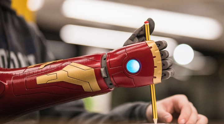 Image shows a hero prosthetic arm holding a pencil