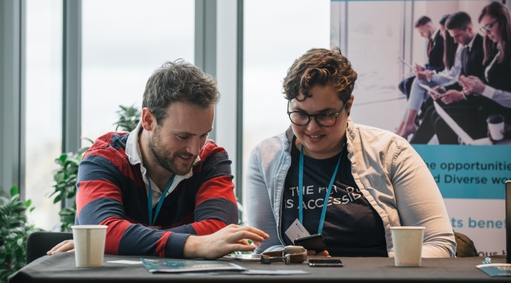 2 people looking happy using tech at TechSharePro