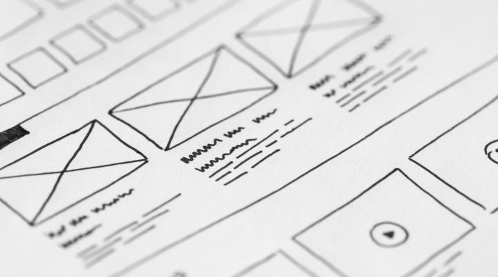 Image shows a pencil sketch of a web page design