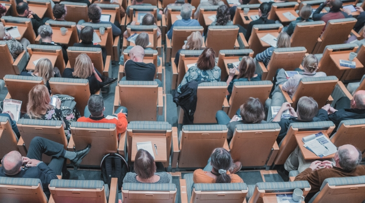 Group of people sitting in a lecture theatre