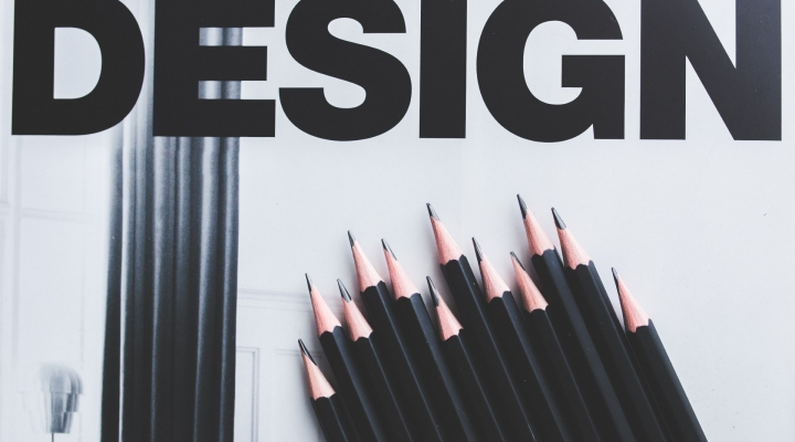 Image of a collection of black pencils with the word 'Design' above it