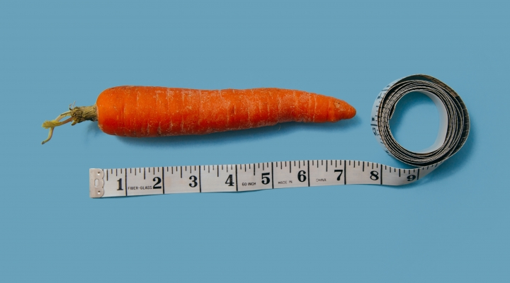 Image shows a carrot with a tape measure alongside it