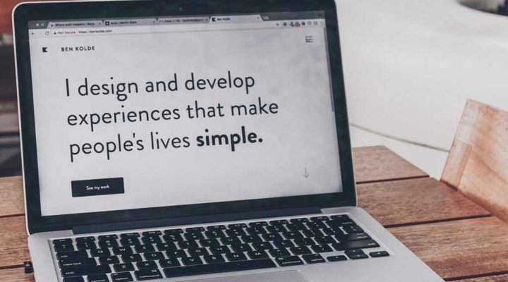 Laptop saying 'I design and develop experiences that make people's lives simple'