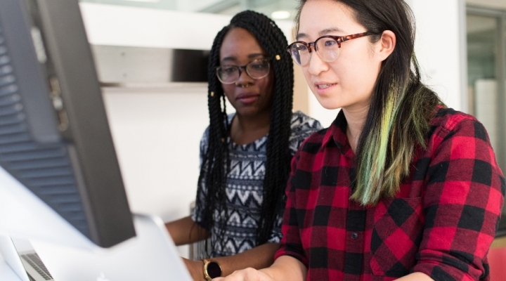 Two students at computer