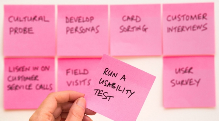Set of 8 post it notes with one in the foreground reading 'Run a usability test'