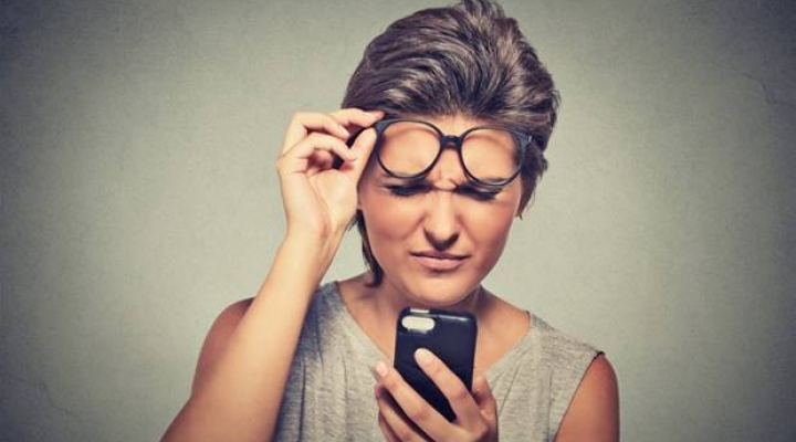 Woman squinting at phone